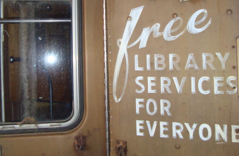 The side of the Door County bookmobile states its mission: to deliver free library services for everyone. Image courtesy of Julie Hein.The side of the Door County bookmobile states its mission: to deliver free library services for everyone. Image courtesy of Julie Hein.