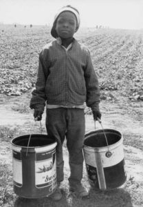 A nine year old migrant worker leaving the pickle fields on strike against Libby, McNeill, & Libby Inc. food company in 1967. Image courtesy of the Wisconsin Historical Society, Image ID: 91644.