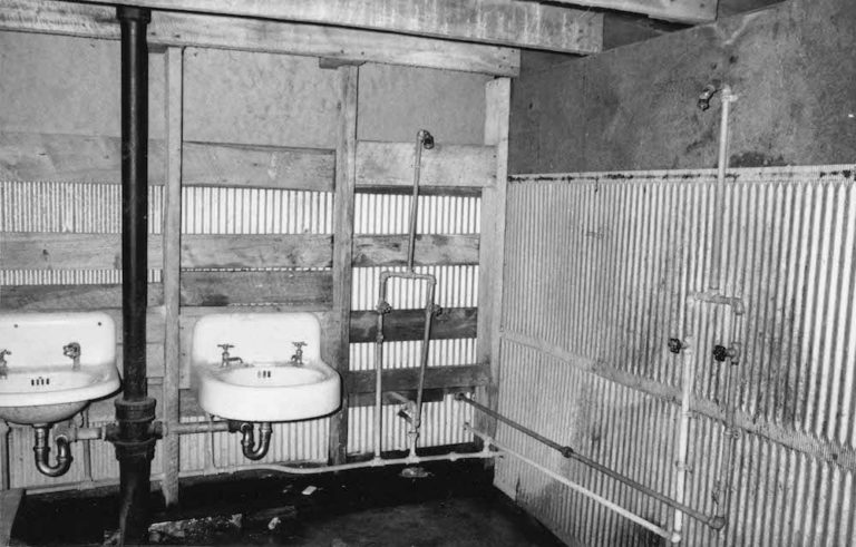 The interior of a communal shower at a Wisconsin migrant worker camp, 1969. Photo by David Giffey, image courtesy of the Wisconsin Historical Society, Image ID: 91703.