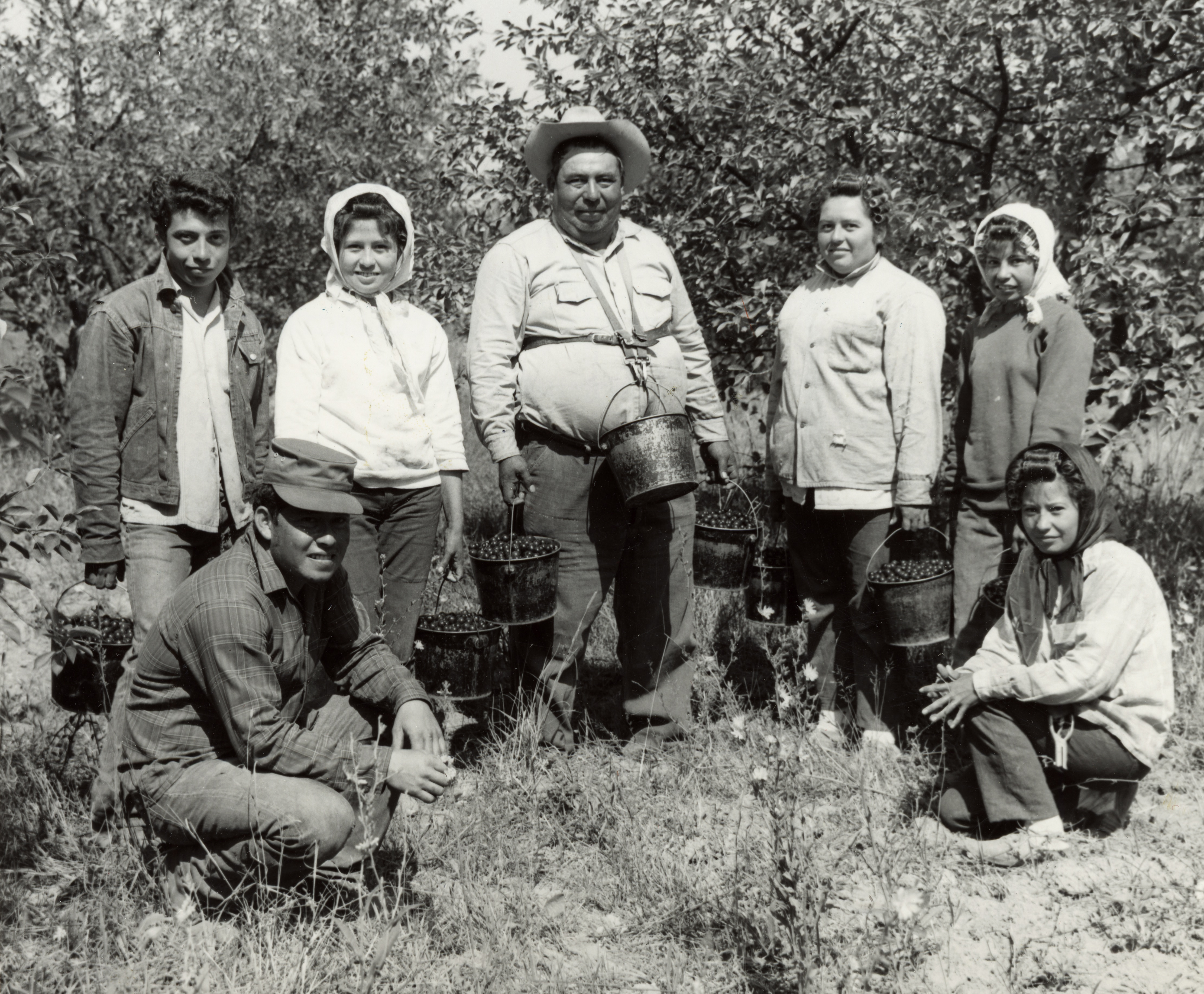 A migrant worker family in a Door County cherry orchard. Image courtesy of the Wisconsin Historical Society. Image ID: 48938.