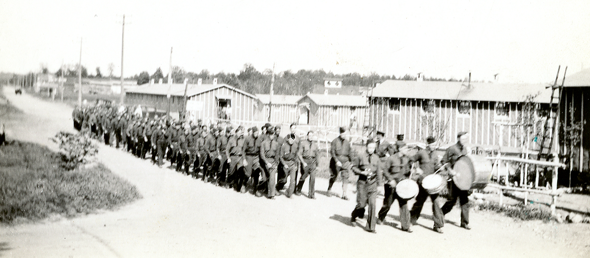 CCC Camp 657 recruits marching from Summit Lake to their new barracks at Elcho, WI, 1933. Photograph courtesy of the Langlade County Historical Society.