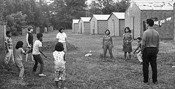 Children playing catch at Bond Village. Image courtesy of the author.