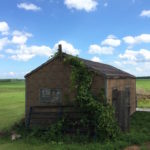 color photo of a no longer used migrant workers cabin