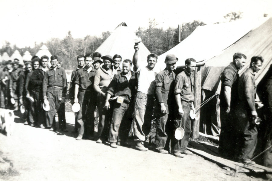 Civilian Conservation Corps recruits in line for the mess hall at Camp 657's temporary location near Summit Lake, Wisconsin, c. 1933. Photograph courtesy of the Langlade County Historical Society.