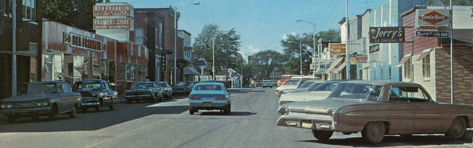 cars on a 1970s downtown street