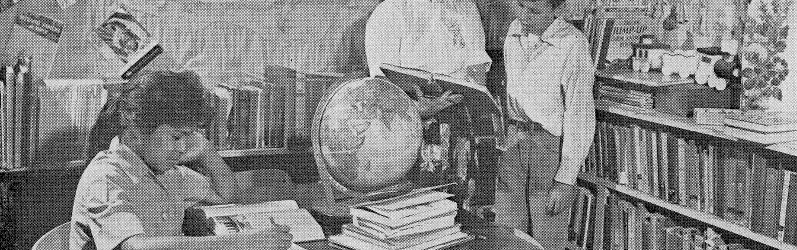Image of students in a library with a teacher