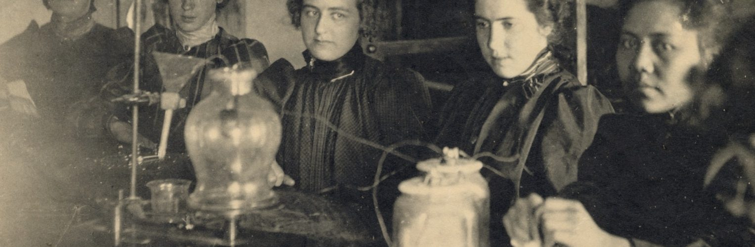 young women in a chemistry class performing an experiment
