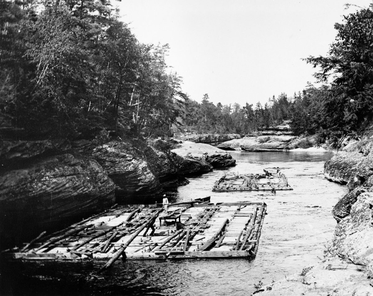 Lumber rafts on the Wisconsin River near the Wisconsin Dells, c. 1886. Photograph by H.H. Bennett, courtesy of the Wisconsin Historical Society, Image ID 6314.