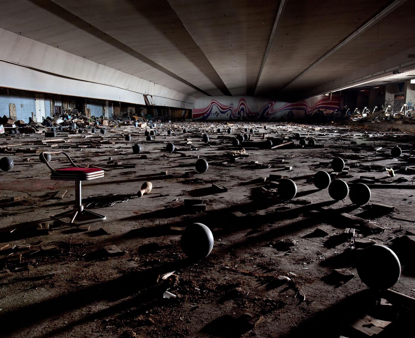 The abandoned Kanagawa Toyo bowling alley in Yokohama, Japan. Opened in 1987 with 108 lanes, the alley fell on hard times in the early 1990s. Photograph by Thomas Jorion, 2009.