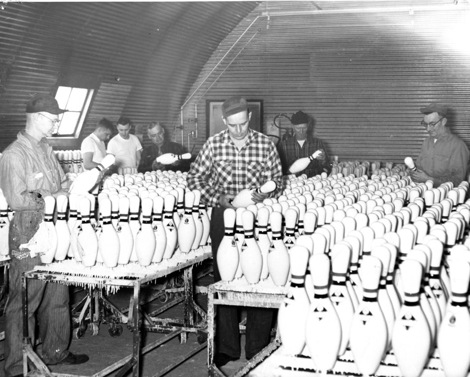 Inspecting pins coming off the Vulcan assembly line, 1954. Photograph courtesy of the Langlade County Historical Society.