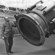 Image of a man standing next to the end of the Yerkes Telescope