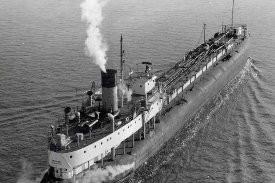 A black and white image of the whaleback ship, the SS Meteor steaming across one of the Great Lakes
