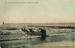An image of a lifesaving crew pushing a row boat out onto the lake beside a pier.