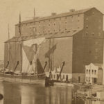 An image of what is believed to be the Tanner before a grain elevator on the lake.