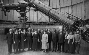 A group portrait inside the Yerkes Observatory featuring Albert Einstein and members of the observatory staff, including several women.