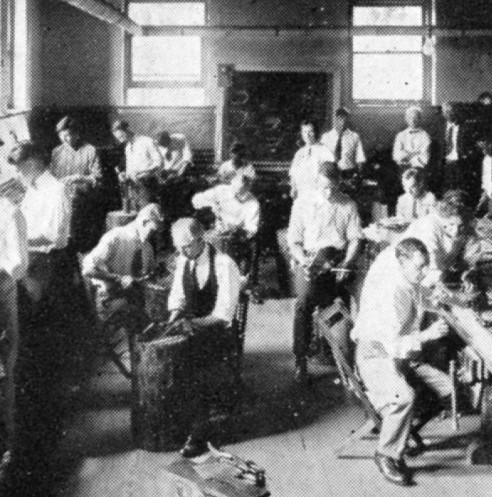 image showing a class of students in the late afternoon sun working in a metalsmith shop