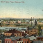 a color postcard showing a bird's eye view of downtown Wausau