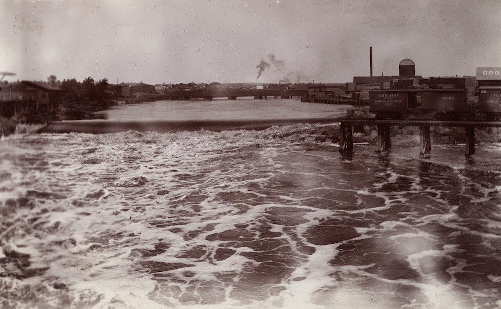 a black and white photograph showing the falls along the Wisconsin River that made Wausau attractive for logging interests