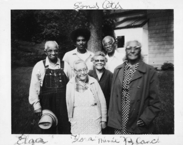 A portrait of an african american family of six adults at their farm in Vernon County, WI.