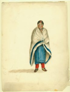 A Native American woman wearing a white trade blanket with a wide blue stripe along its edge.