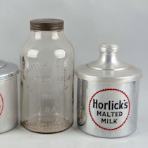 a picture of three containers of Horlicks Malted Milk, one in a glass bottle and the other two aluminum with lids