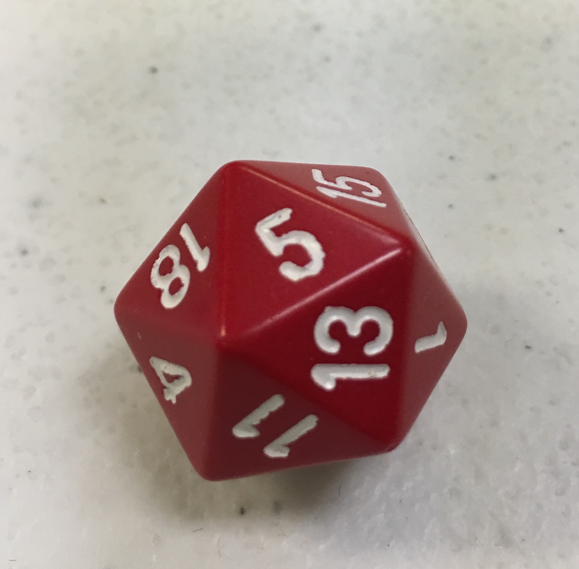A color photo of a red twenty-sided die