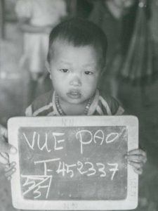A black and white image of the author as a young boy in a Thai refugee camp