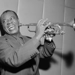 Portrait of Louis Armstrong with his Trumpet.
