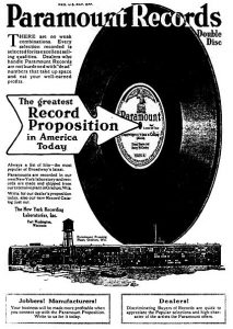 Paramount Records double disc advertisement showing a large record moving over the Grafton plant