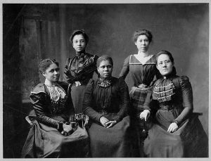 A black and white photo showing five African American women