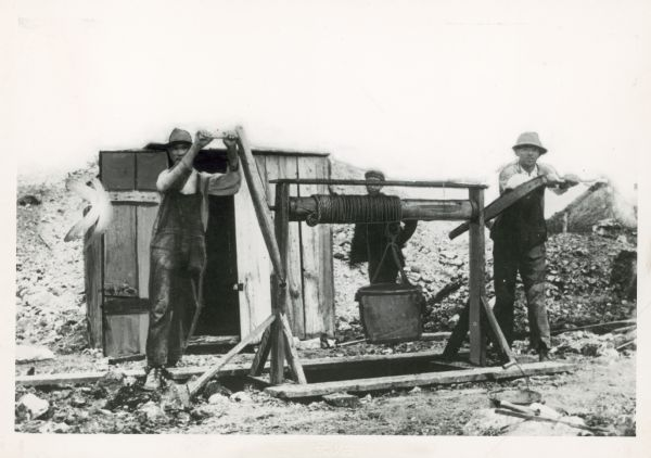 photo of early Wisconsin lead miners operating a windlass