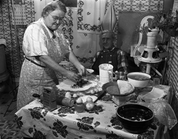 A woman making pasties in a black and white photo