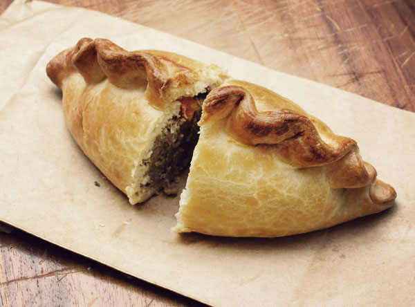 an image of a cut cornish pasty showing the filling and edging