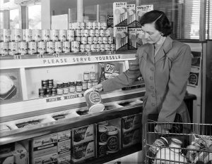 Image of a woman shopping in the frozen foods section of a grocery store