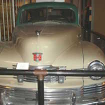 a cropped image of the front of a Nash automobile