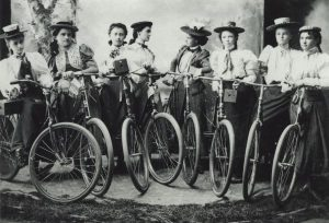 A group of women posing with bicycles