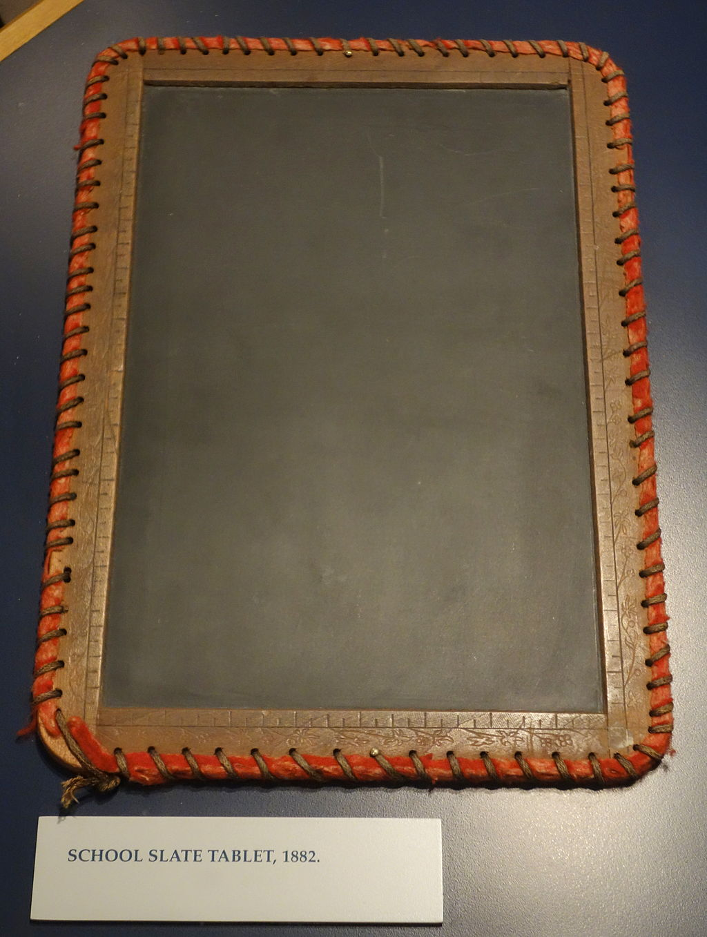 image of a slate tablet with bound edges
