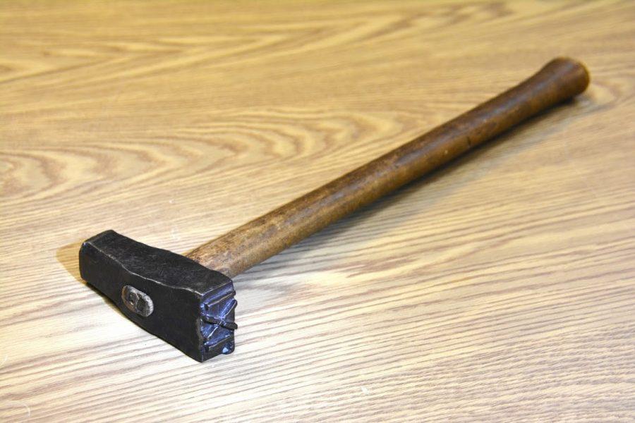 An image of a log marking hammer