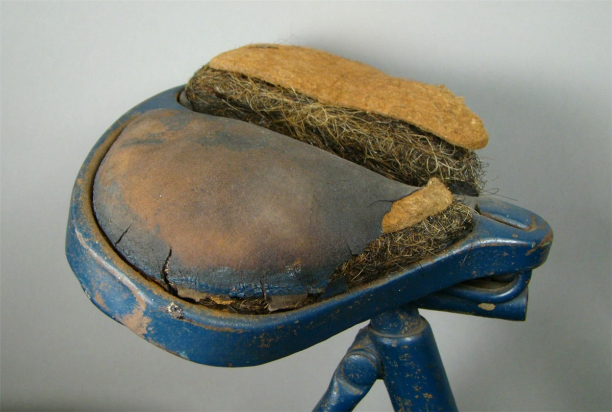 a close-up of a safety bicycle's padded seat