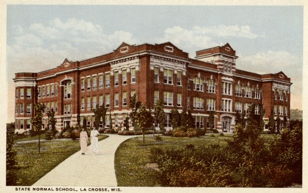 a color postcard showing a newly built brick building with students walking in front