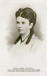 a portrait of a young woman wearing a light colored dress