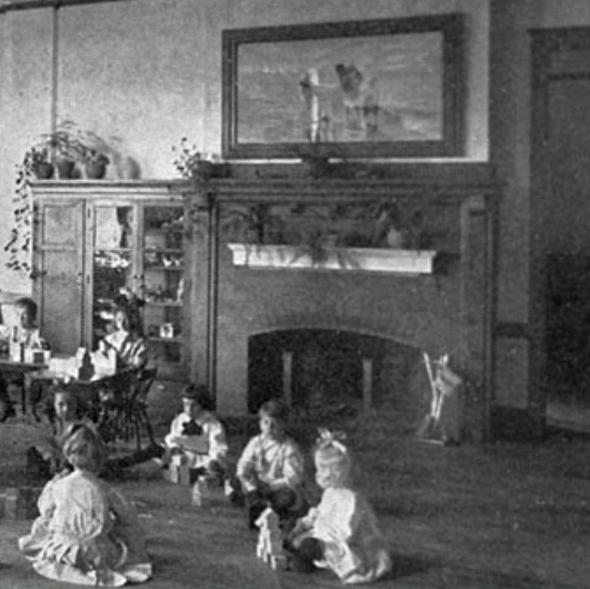 an image of children playing before a fireplace