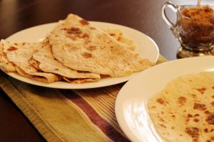 Cooked lefse on plates ready to be eaten!