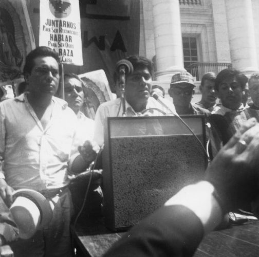 Jesus Salas addresses the crowd from the steps of the statehouse